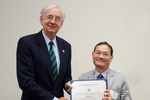 Dr. Minh Dao, Economics, with Dr. William L. Perry, President