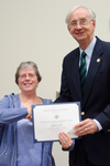 Dr. Janice Coons, Biological Sciences, with Dr. William L. Perry, President