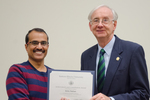 Dr. Britto Nathan, Biological Sciences, with Dr. William L. Perry, President