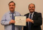 Radu Semeniuc, ACA winner for Research, with President David Glassman by Jay Grabiec