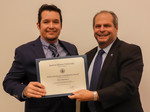 Eloy Martinez, ACA winner for Research, with President David Glassman by Jay Grabiec