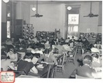 Original Library in Old Main (Reserve Reading Room Showing Magazine Racks) by University Archives