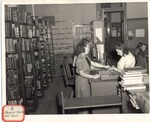 Original Library in Old Main (Reserve Shelves and Desk) by University Archives