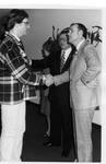 President Marvin Being Congratulated By Well-Wisher
