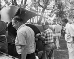 Men Grilling Meat At President Marvin'S Farewell Picnic