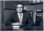 President Stanley G. Rives Seated at His Desk by University Archives