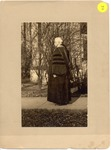 President Livingston Lord Standing In His Cap And Gown by University Archives