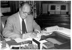 President Robert  Guy Buzzard Seated At His Desk