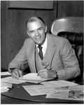 President Daniel Marvin Seated At His Desk