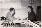 President Quincy V. Doudna Engaged in Conversation by University Archives