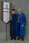 Dr. Roger Beck, Faculty marshal, Dr. William L. Perry, President