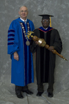 Dr. William L. Perry, President, Dr. Godson C. Obia, Commencement marshal