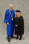 Dr. William L. Perry, University President,  Ms. Anita Sego, Faculty Marshal