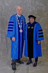 Dr. William L. Perry, University President,  Dr. Kiranmayi Pamaraju, Faculty Marshal