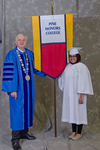 Dr. William L. Perry, University President, Ms. Shirmeen Ahmad, The Pine Honors College banner carrier