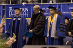 Dr. Robert D. Webb, Board of Trustee, Dr. H. Ray Hoops, Honorary degree recipient, charge to the class, Mr. Eric Wilber, Student trustee