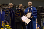 Dr. Blair M. Lord, Provost and Vice President for Academic Affairs, Dr. H. Ray Hoops, Honorary degree recipient, charge to the class, Dr. William L. Perry, President by Beverly J. Cruse