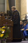 Dr. H. Ray Hoops, Honorary degree recipient, charge to the class by Beverly J. Cruse