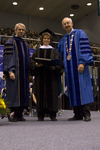 Dr. Blair M. Lord, Provost and Vice President for Academic Affairs, Dr. Janet M. Treichel, Honorary degree recipient, charge to the class, Dr. William L. Perry, President