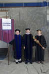 Dr. Richard E. Cavanaugh, Faculty marshal, Dr. William C. Hine, Dean of School of Continuing Education, Dr. Marilyn J. Coles, Commencement marshal