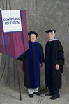 Dr. Richard E. Cavanaugh, Faculty marshal, Dr. William C. Hine, Dean of School of Continuing Education