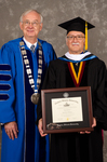 Dr. William L. Perry,  President, Dr. Gordon L. Grado, Honorary Degree Recipient