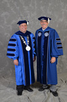 Dr. David Glassman  & Mr. Daniel P. Caulkins, Member of Board of Trustees