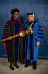 Dr. Catherine Polydore, Commencement Marshal, President David Glassman, University President by Beverly Cruse