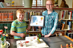 """Caitlin and Olivery Rednour won the Best Family Entry with """"The Snowy Day"""" by Bev Cruse"""