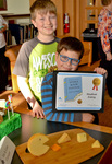 """Ian and Liam Corrigan, winners of the Student Entry Best in Show for """"The Missing Piece"""" by Bev Cruse"""