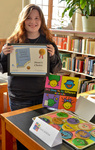 """Katie Jenkins, winner of the Dean's Choice Gold award for """"It's Okay to Be Different"""" by Bev Cruse"""