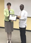 Student Razak Dwomoh with Dr. Nora Pat Small by Beth Heldebrandt