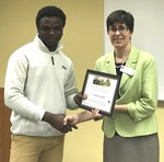 Student O. Tomiwa Shodipe with Dr. Nora Pat Small by Beth Heldebrandt