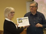 Librarian David Bell presents a certificate to Professor Lynne Curry by Beth Heldebrandt