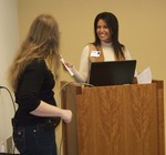 Librarian Stacey Knight-Davis presents a certificate to speaker Michele Hartke by Beth Heldebrandt