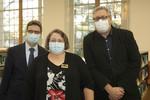 Dean Zach Newell, Arlene Brown and David Bell demonstrate flu masks by Beth Heldebrandt
