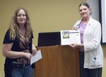 Librarian Stacey Knight-Davis presents a certificate to speaker Ramona Tomshack by Beth Heldebrandt