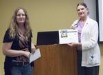 Librarian Stacey Knight-Davis presents a certificate to speaker Ramona Tomshack by Beth Heldebrandt