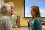 John and Karen Whisler visit with Mortenson Center