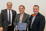 President Glassman and Jay Gatrell, V.P. of Academic Affairs with Minh Dao by Beverly Cruse