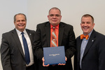 President Glassman and Jay Gatrell, V.P. of Academic Affairs with Reverend Chris Prater accepting on behalf of Wafeek Wahby by Beverly Cruse