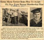 Sainte Marie Farmer Stops Plow To Accept His New Farm Bureau Membership Plate (Seaman First Class Edmund F. Fowler) 10-4-1945